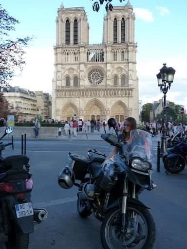 Traveling to Paris by motorbike - parked outside Notre Dame